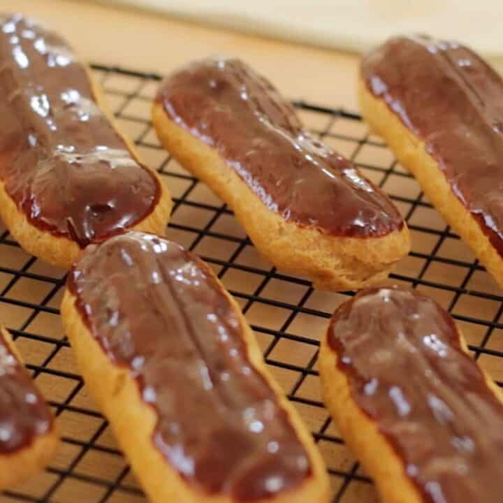 Chocolate Eclairs on a cookie rack
