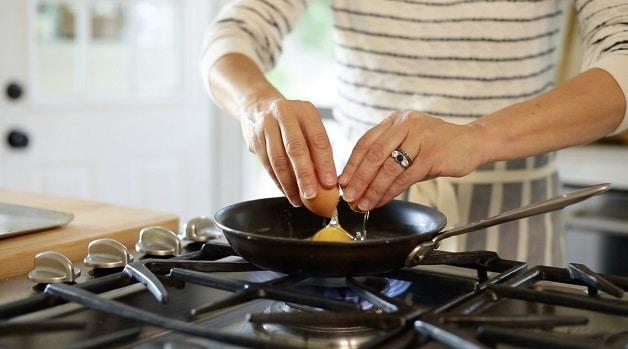 Cracking egg in pan