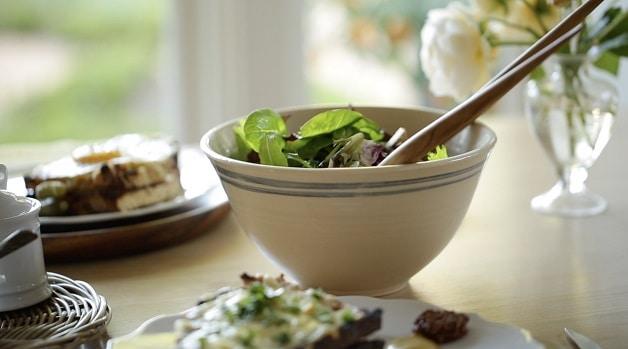 White bowl of salad greens