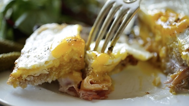 Piece of croque madame on fork