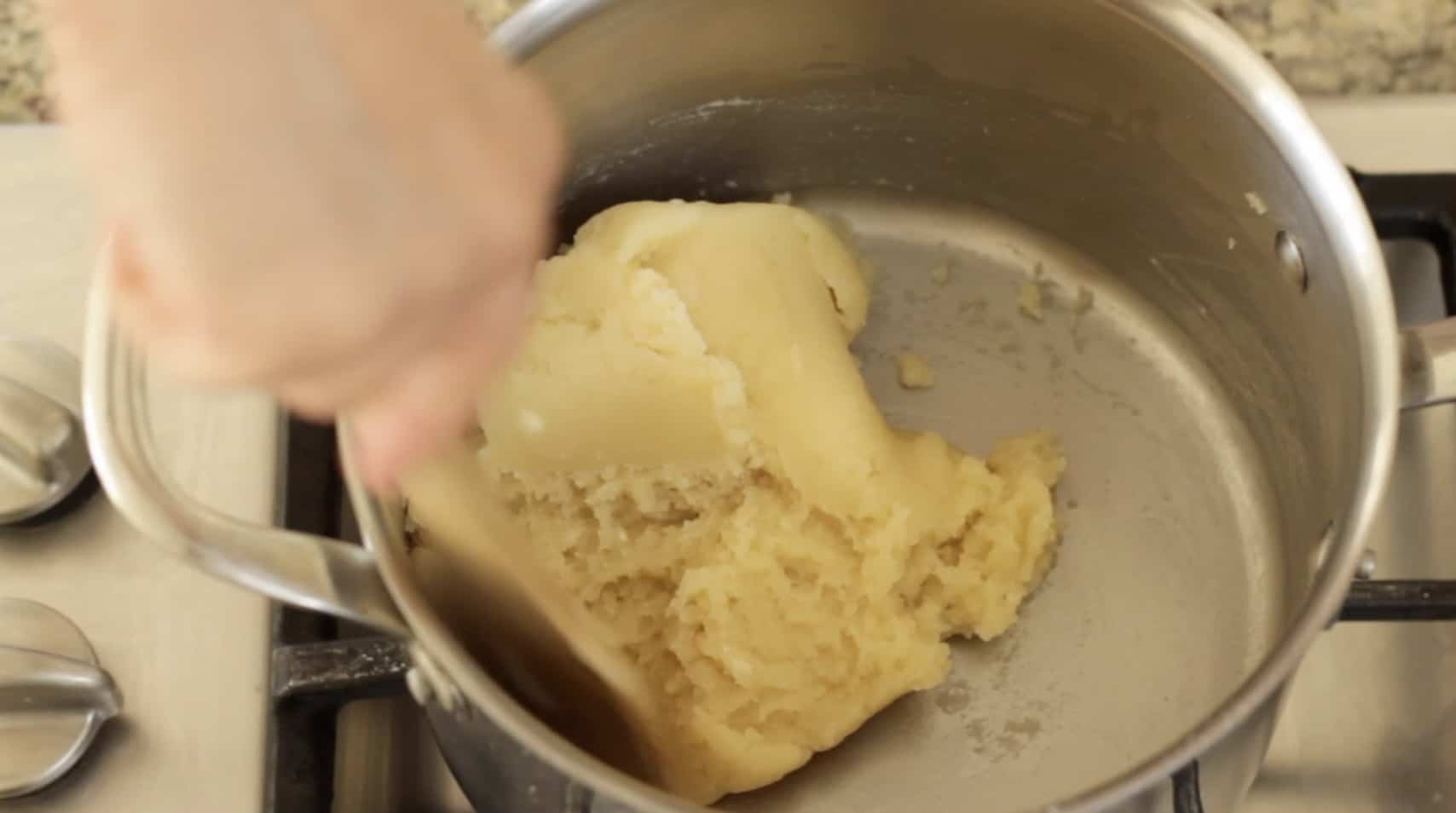 Dough ball being formed as it pulls away from the sides for choux pastry