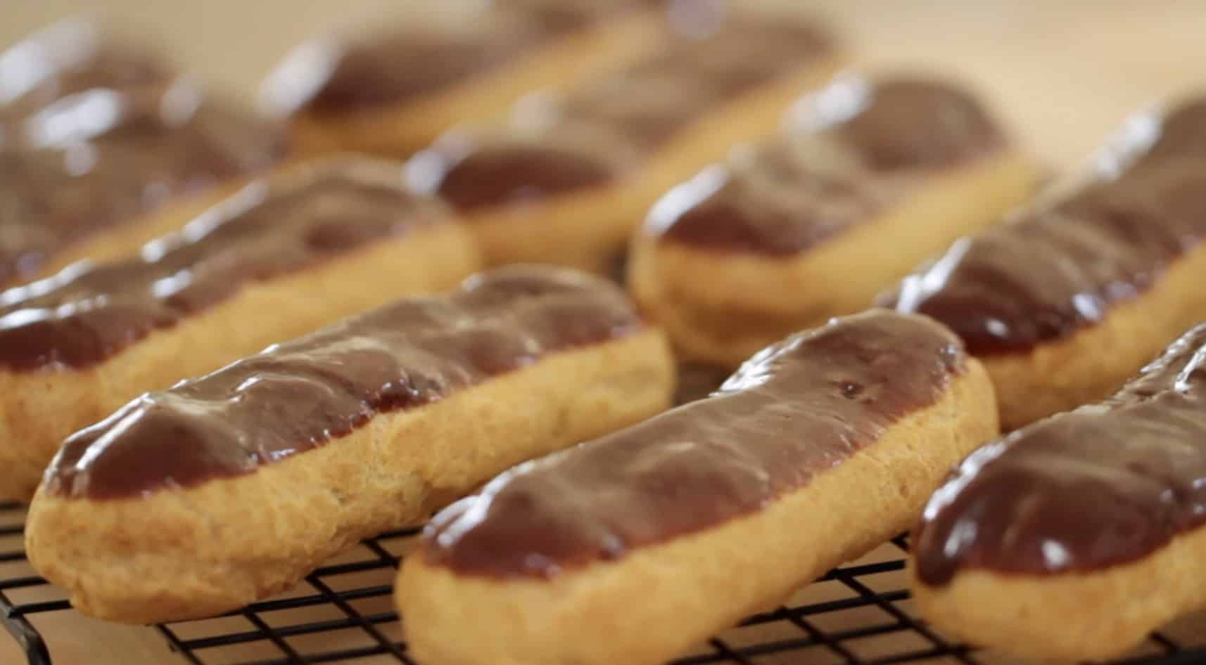 Chocolate eclairs on a cooling rack cooling