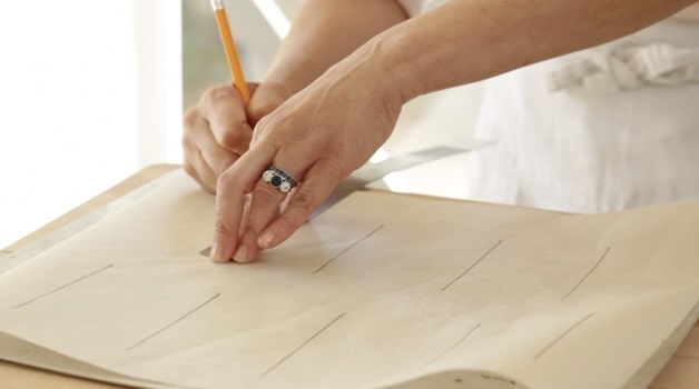 """drawing 4"""" lines with pencil on parchment paper"""