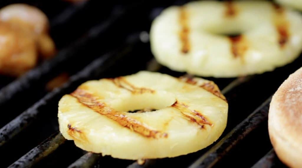 Grilling Pineapple slices on a BBQ
