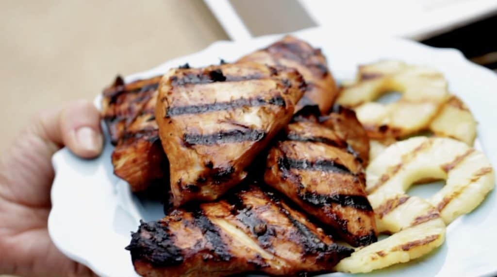 A plate of Grilled Teriyaki Chicken Breasts and Grilled Pineapple