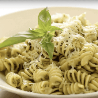 How to Make Pesto Sauce served with pasta in a white bowl