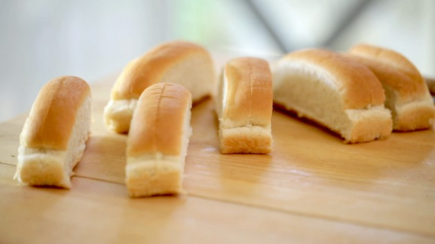 split top buns on a cutting board