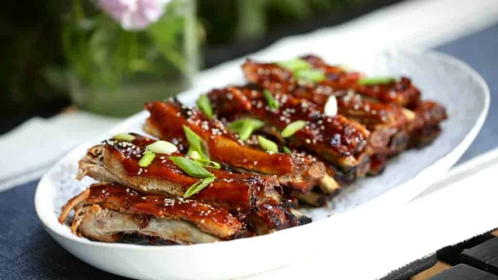 BBQ Ribs Recipe garnished on a platter and ready to be served