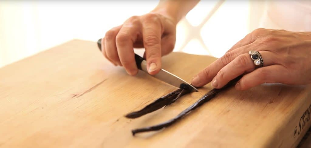 Vanilla Bean pod being scraped of its seeds
