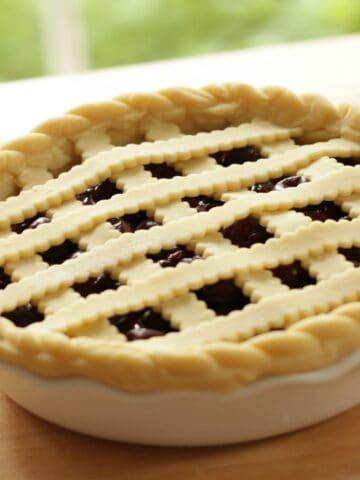 CHerry Pie with Lattice Dough Crust in white Pie Plate