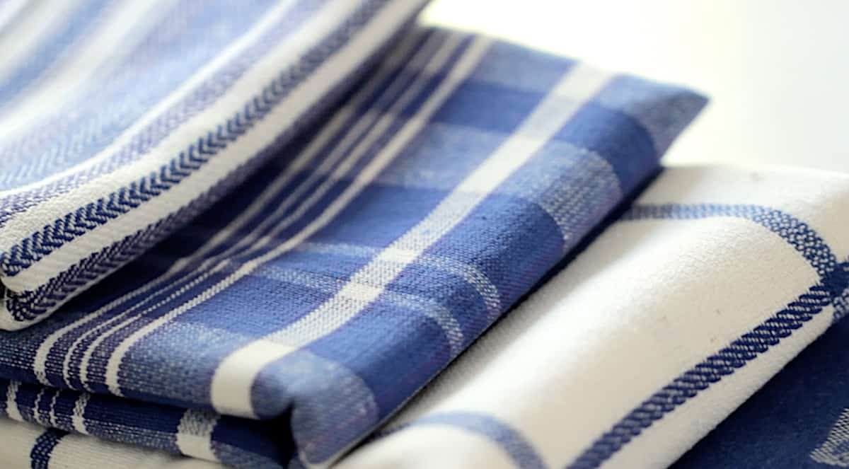 a stack of blue and white dish towels