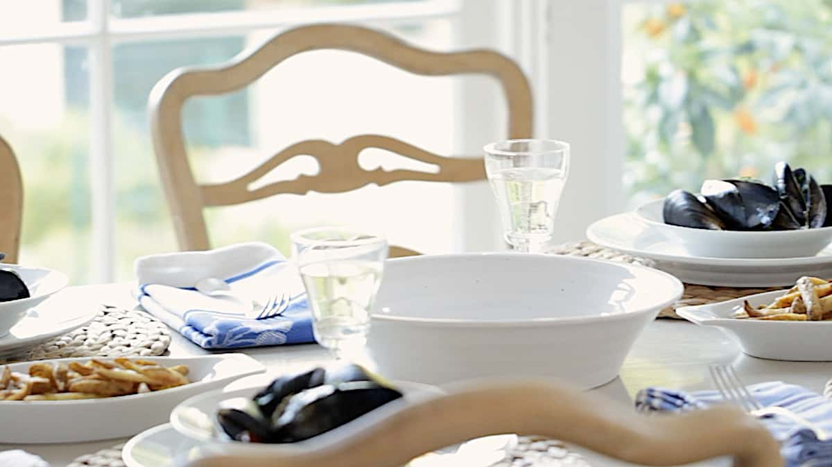 a table set for serving mussels