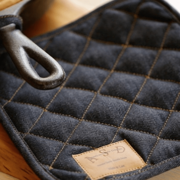Denim Pot Holder on handle of a cast-iron skillet