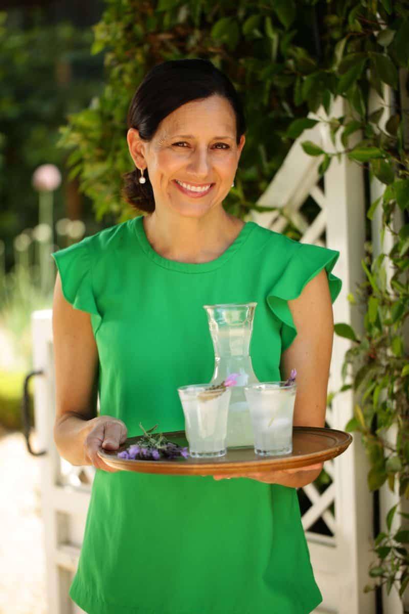 Beth Le Manach holding a platter of Lavender Lemonades