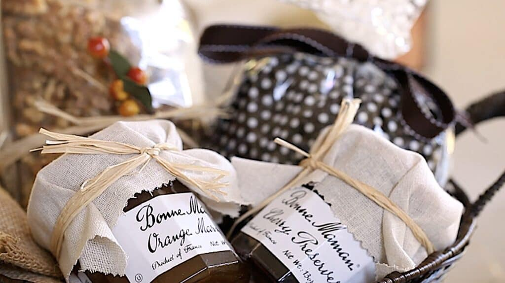 a basket of packaged pumpkin bread, jams and coffee