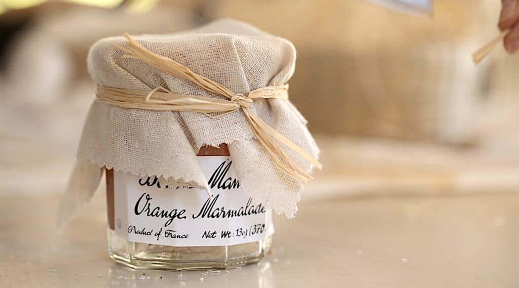 a jam jar with a fabric top, tied with raffia