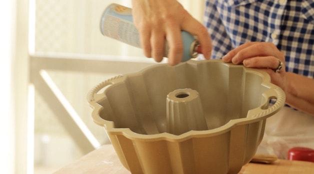 Spraying a bundt pan with baking spray