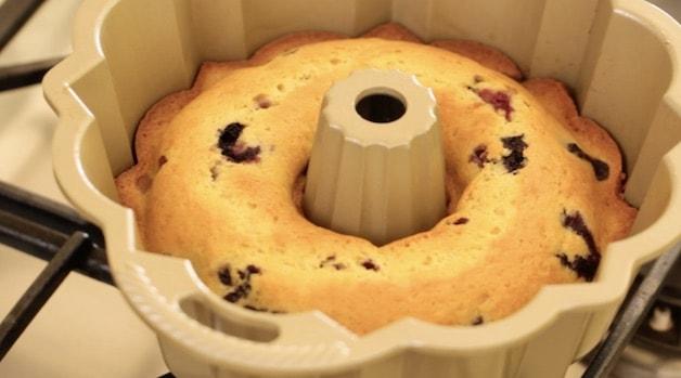 a lemon blueberry bundt cake cooling in a bundt pan