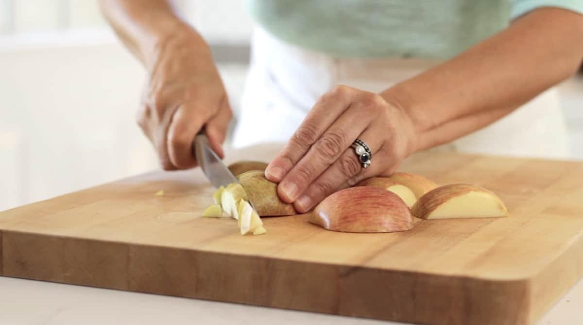 Cutting apples on a cutting board