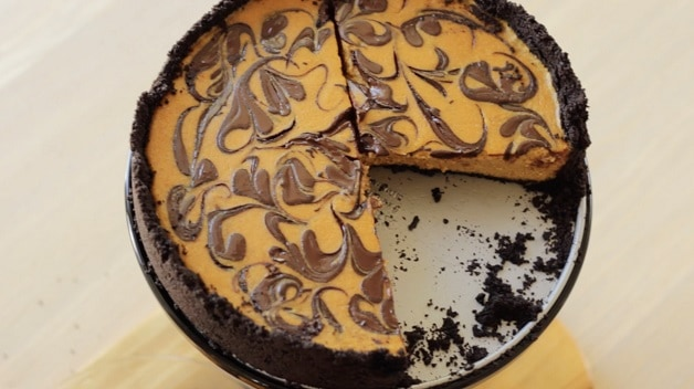 Overhead shot of Chocolate Pumpkin Cheesecake with missing slice