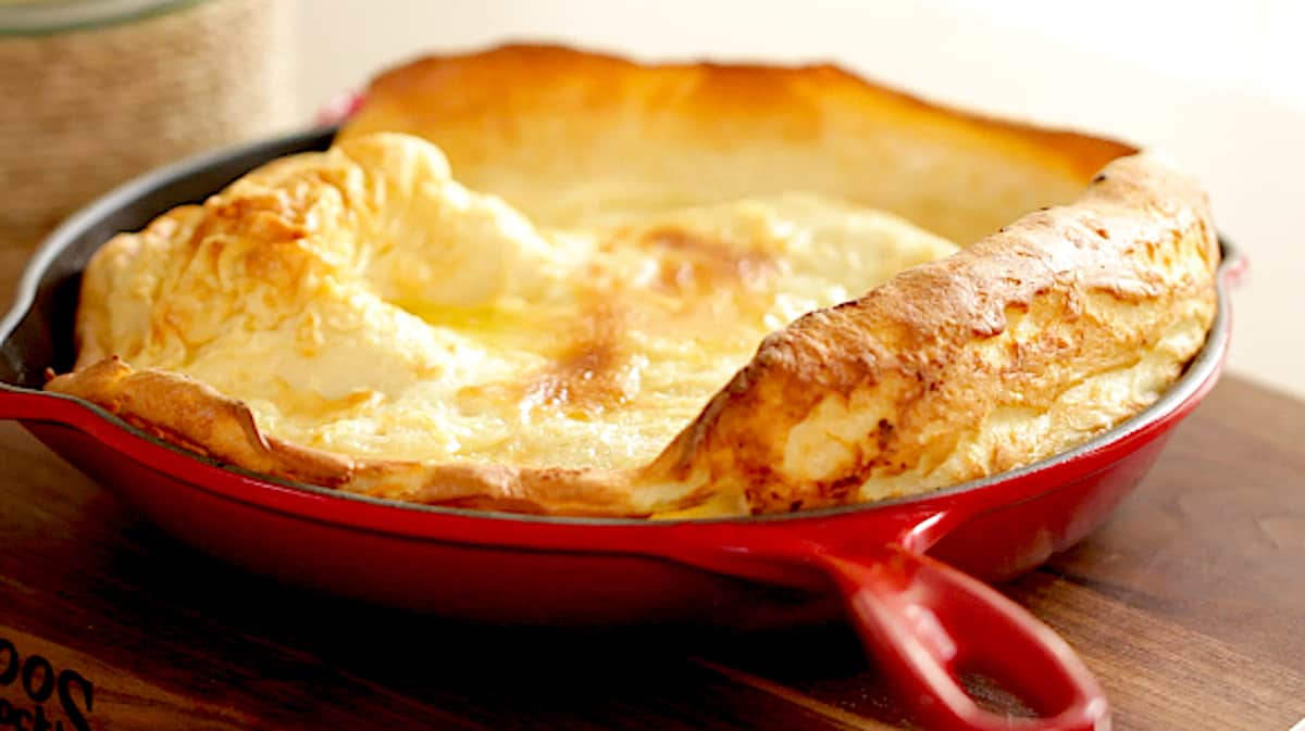 A dutch baby pancake baked in a cast iron skillet