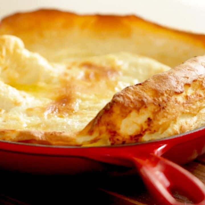 Dutch Baby Pancake fresh from the oven in a Red Skillet