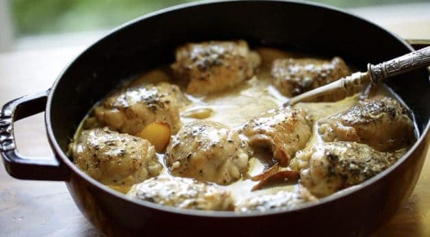 One Pot Chicken and Potato Recipe in a large casserole with silver serving spoon