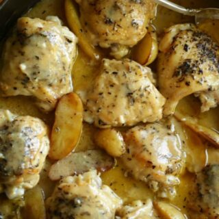 One Pot Chicken and Potatoes Recipe in red braiser