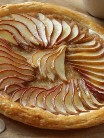 Pear Tart made with puff pastry on a board