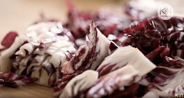 Radicchio being sliced for a fall harvest salad