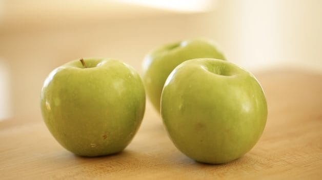 Granny Smith Apples on a cutting board
