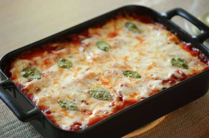 A freshly baked casserole of a Veggie Lasagna Roll-Ups ready to be served