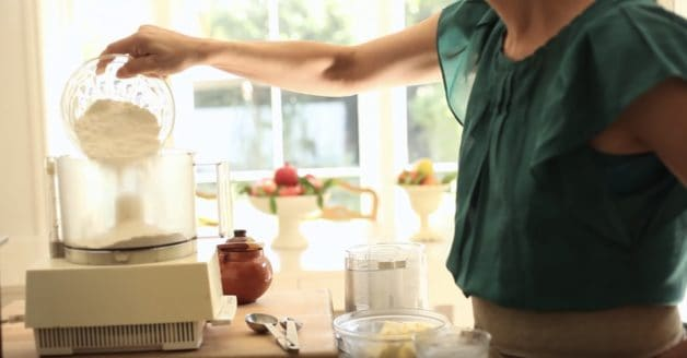Adding flour to a food processor