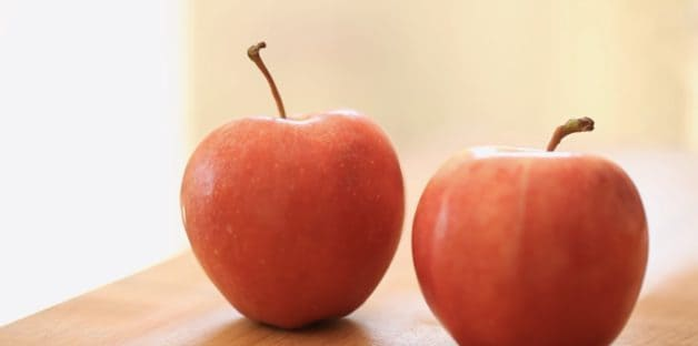 Two Gala Apples on a Cutting Board