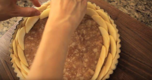 Adding apple slices to tart in an escargot pattern