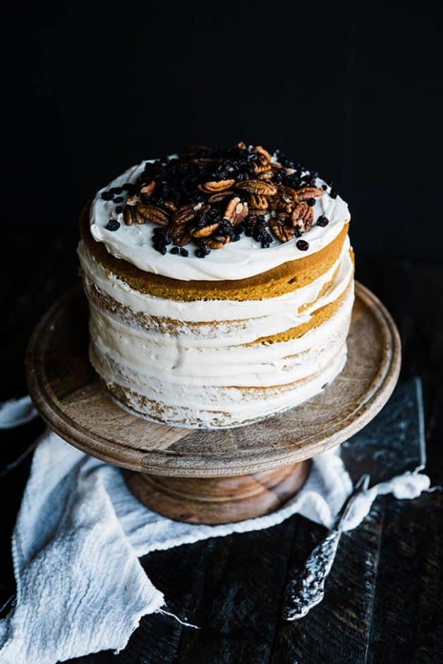 Pumpkin Cake on a cake stand with cream cheese frosting created by Billy Parisi