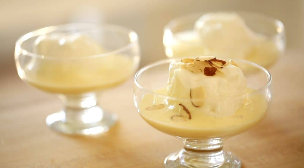 Floating Islands on bowls with almonds on top