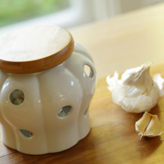Ceramic Garlic Keeper with wooden top from a list of 15 Gifts for Foodies