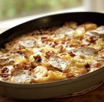 Easy Tartiflete Recipe in an oval Staub Gratin Pan