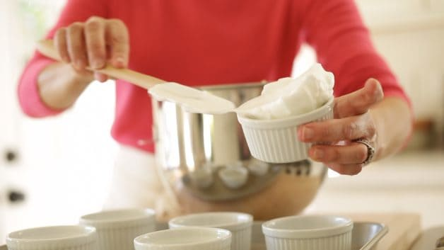 Placing egg whites in a ramekin for Easy Ile Flottante Recipe with Spun Sugar