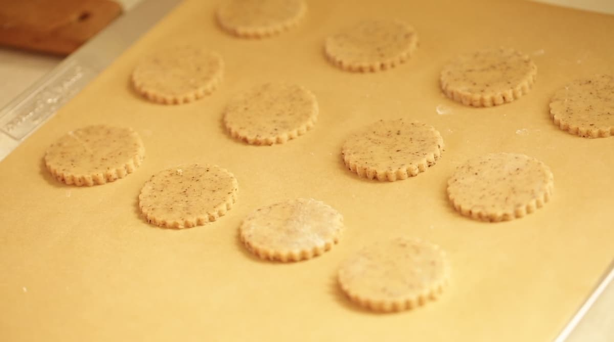 Cookie Bottoms cut out and placed on a sheet tray