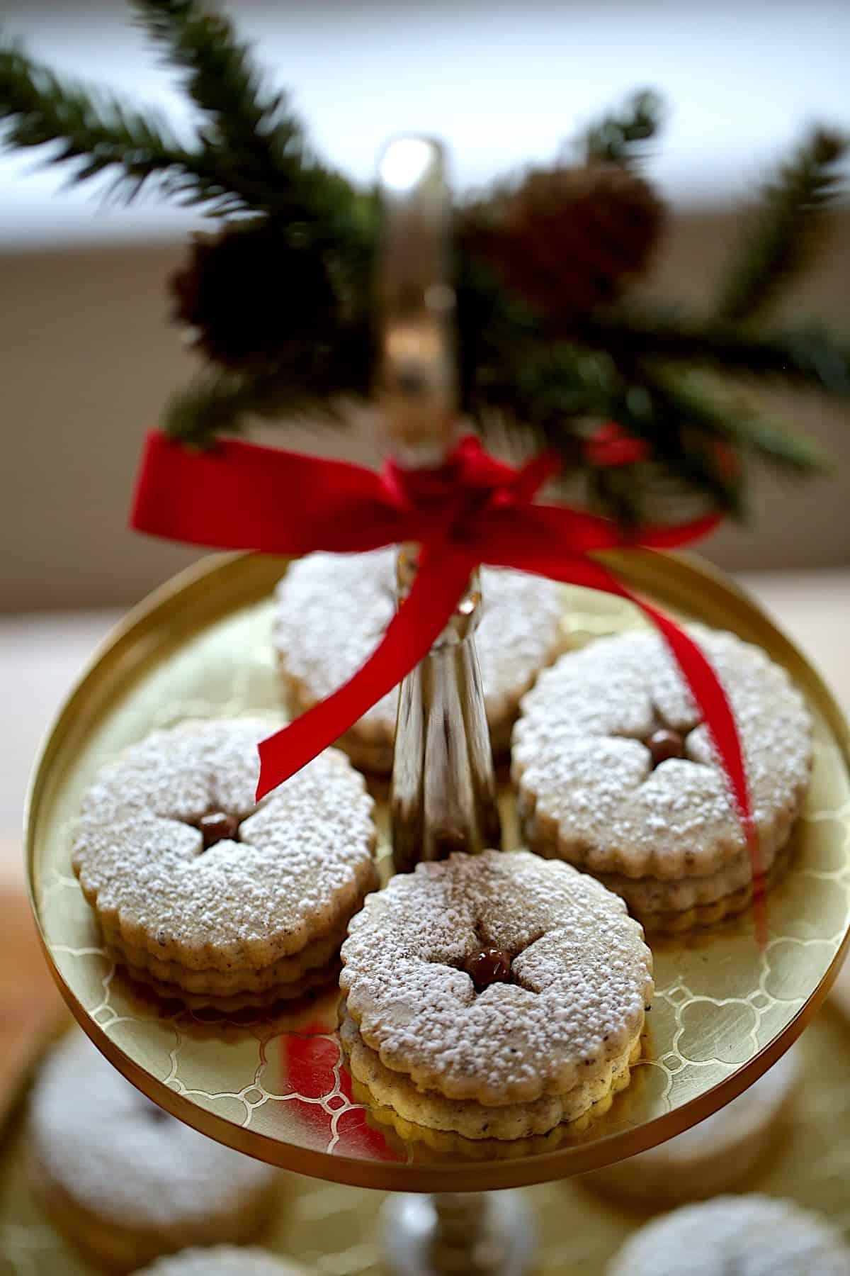 Hazelnut Chocolate Linzer Cookies on a gold platter