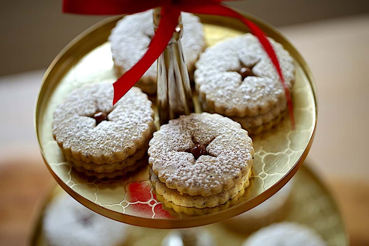 Close up of Chocolate Hazelnut Linzer cookies with powdered sugar