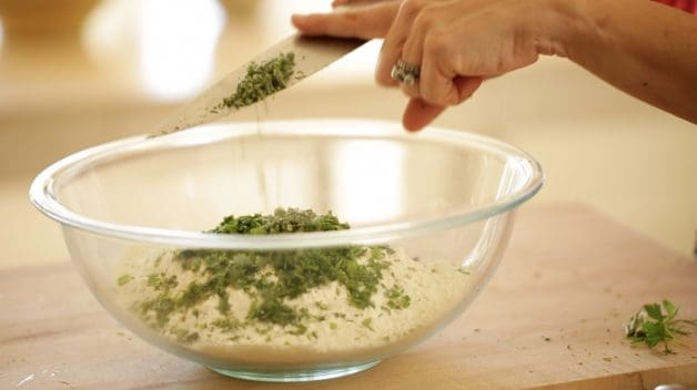 mixing fresh herbs into flour mixture