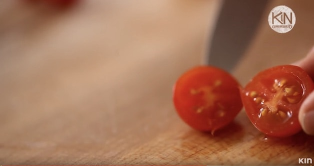 Cherry tomato cut in half revealing the interior seeds