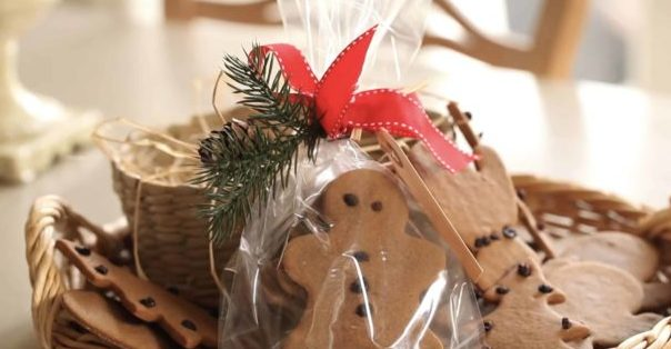 Gingerbread Cookies packaged up with Christmas Evergreen and Red Ribbon