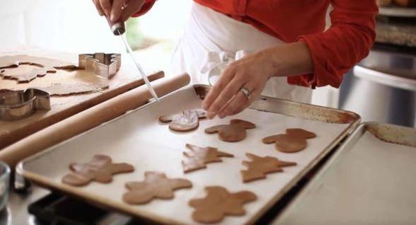 Placing an Easy Gingerbread Cookie Recipe onto baking trays