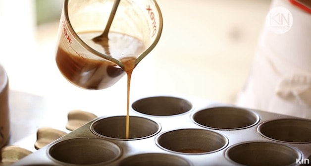 Sticky Bun Sauce being poured into muffin tin