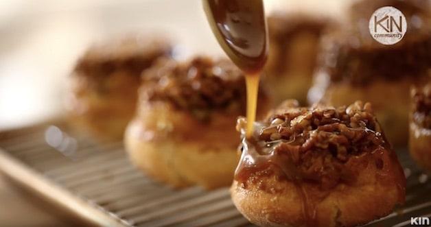 Pouring sticky sauce on sticky buns