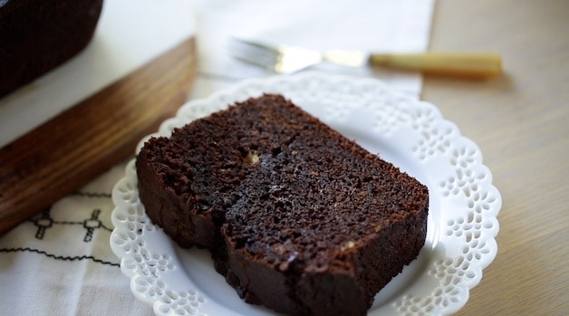 a piece of chocolate banana bread on a white plate